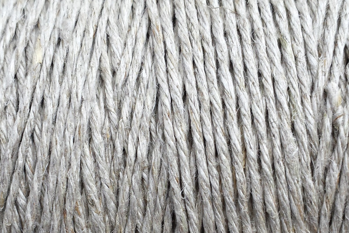 A photo of a spool of our new hemp string, a weathered-looking 6-ply hemp twine.