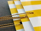 Canary yellow and winter white striped tags on thin stock strung with 4-ply gold lamé.