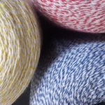 Spools of red, blue, and yellow bakery twine.