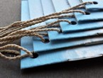 Blue booklets with cloud graphic strung with heavyweight bell cord.