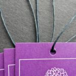 Purple tags with white border and dahlia graphic.