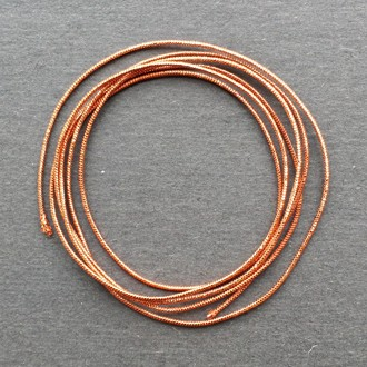 A coil of our copper metallic elastic.