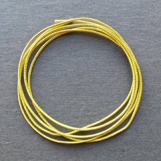 A coil of our gold metallic elastic.