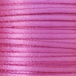 "A spool of 1/16"" double-faced satin ribbon in hot pink."