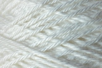 A spool of standard white rayon string.