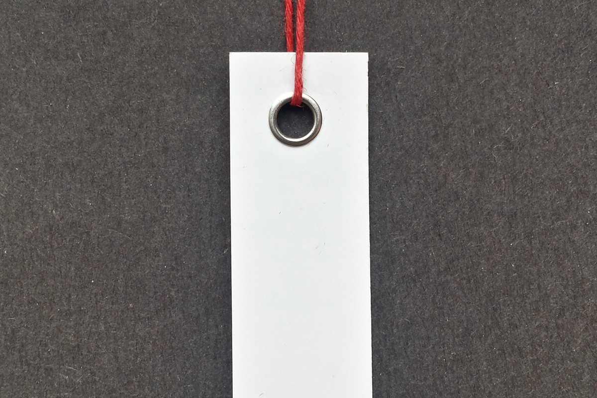 Photograph of a strung hang tag.