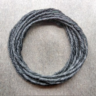 Coil of our heavyweight black cotton string.