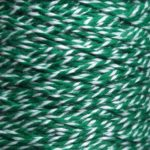 Spool of heavyweight variegated green-white cotton string.