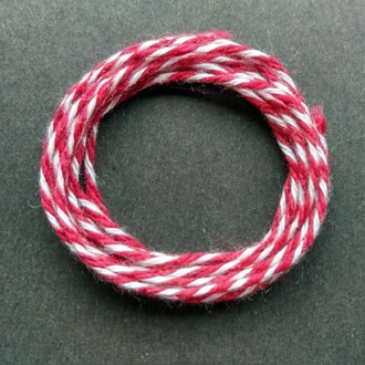 Coil of heavyweight variegated red-white cotton string