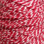 Spool of heavyweight variegated red-white cotton string.