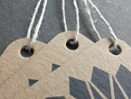 Tags on heavy brown paper stock with geometric graphic element strung with our 3-ply hemp.