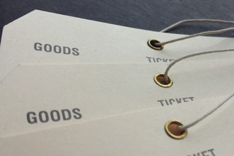 Tags on heavy stock for industrial/commercial use with brass eyelets and polished cord.