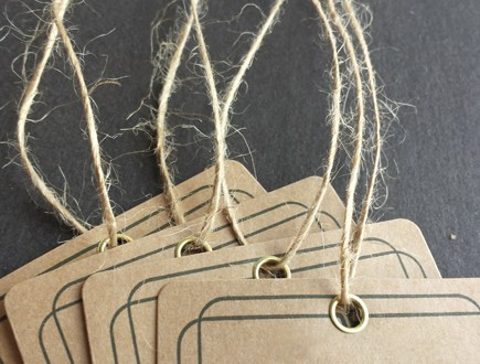 Square tags with border detail and brass eyelets strung with our jute twine.