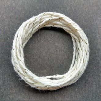 Coil of gold-natural metallic yarn