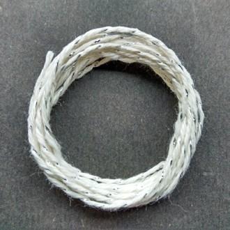 Coil of silver-white metallic yarn