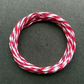 Coil of middle-weight variegated red-white cotton string