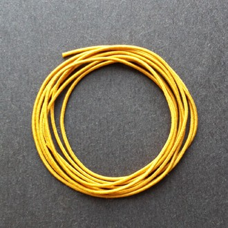 A coil of our gold non-fray elastic.