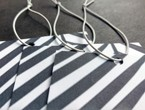 Tags with black and white striped graphic elements strung with our #80 elastic in white.