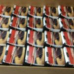 Hang tags that have been bundled, packed up, and made ready to ship.
