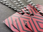Red and black geometric-patterned tags strung with our black-white variegated Pearlray.