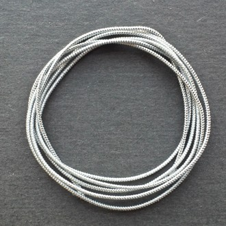 A coil of our silver metallic elastic.