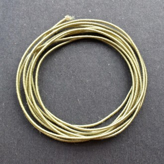 A coil of our standard elastic in antique gold.
