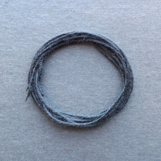 A coil of standard black rayon string.