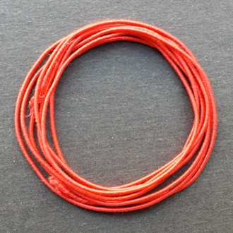 A coil of our standard elastic in red.