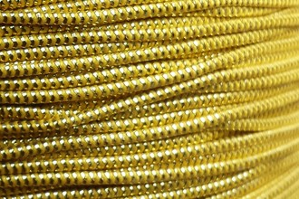 A spool of our gold metallic elastic.