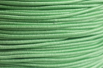 A spool of our rare light green non-fray elastic.