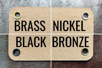 Image showing brown tags with metal eyelets in four finishes: brass, nickel, antique bronze, and dull matte black.