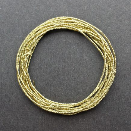 A coil of 4-ply gold lamé.