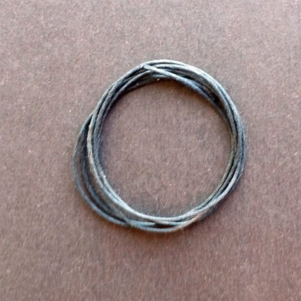 A coil of our black glazed cord.
