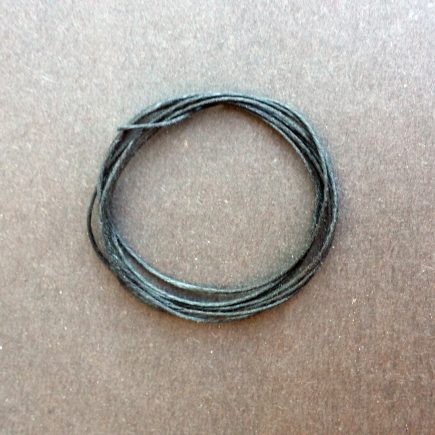 A coil of our black waxed cord.