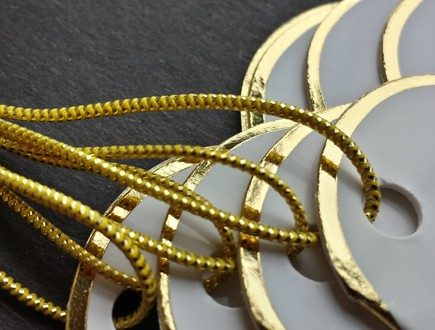 Heart-shaped folded tags with a gold foil border, strung with our gold metallic elastic.