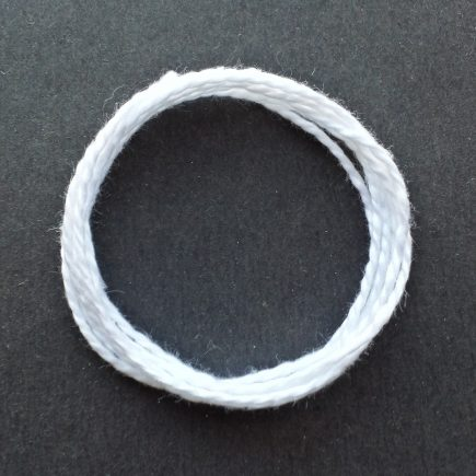 Photograph of a coil of 3/2 mercerized cotton in white.