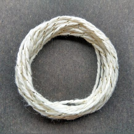 Coil of gold-natural metallic yarn.