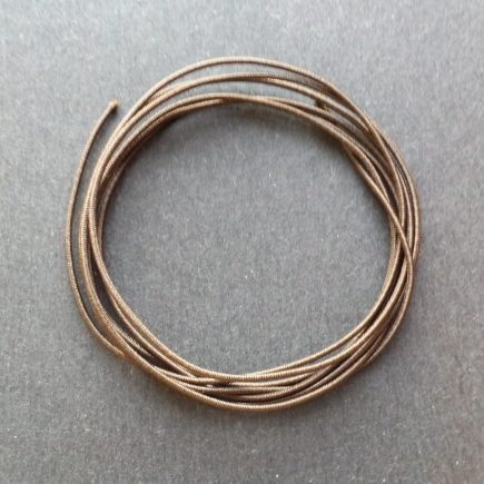A coil of our brown non-fray elastic.