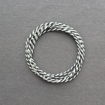 A coil of variegated black-white Pearlray.