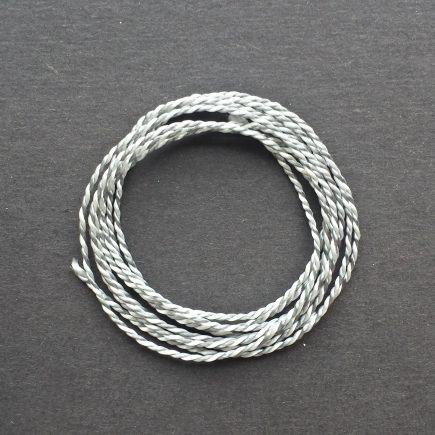 A coil of variegated gray-white Pearlray.