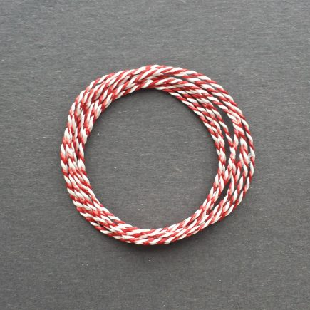 A coil of variegated red-white Pearlray.