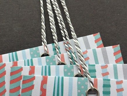 Multi-color gift envelopes strung with our gray-white variegated Pearlray.