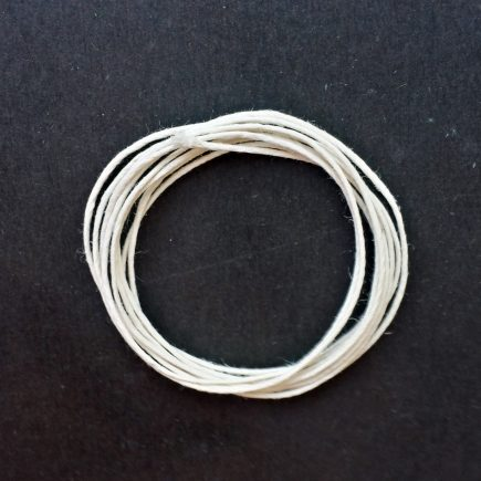 A coil of our polished cord, in its natural color.